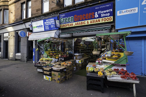Green Grocers shop selling fruit and vegetables on Victoria Road in Govanhill district of Glasgow, Scotland, United Kingdom Govanhill,Glasgow,Scotland,Scottish,district,shop,shops,shopping,greengrocers,grocery store,neighbourhood,inner city,cities,urban,building exterior,United Kingdom,UK,Britain,British,Europe,European,poor,nobody