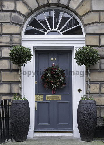 Christmas decorations of front doors of Georgian Houses in the New Town of Edinburgh , Scotland