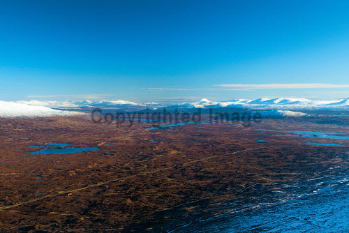 Looking across Rannoch Moor towards Schiehallion from Meall aÕ Bhuiridh, Highlands of Scotland uk,u.k,Great Britain,GB,G.B,Scotland,Scottish,nobody,daytime,outdoors,Highlands,Meall aÕ Bhuiridh,Rannoch Moor,Mountain,Munro,Munros,Winter,Highland,snow