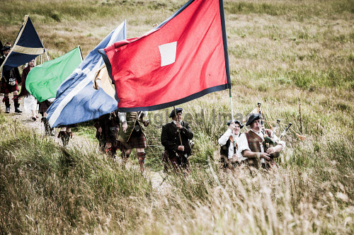 The Loyal Men of Lochaber annual march to Highbridge near Spean Bridge,where the first shot of the 1745 Jacobite uprising was fired. Highlands of Scotland uk,u.k,Great Britain,GB,G.B,Scotland,Scottish,group,daytime,outdoors,Lochaber,flags,banners,tradition,tradional,tartan