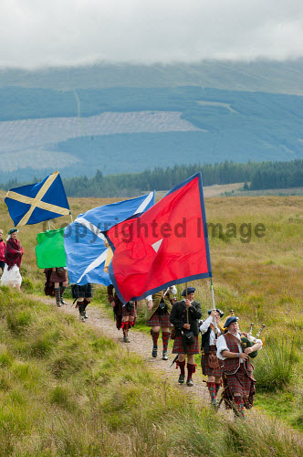 The Loyal Men of Lochaber annual march to Highbridge near Spean Bridge,where the first shot of the 1745 Jacobite uprising was fired., Highlands of Scotland uk,u.k,Great Britain,GB,G.B,Scotland,Scottish,group,daytime,outdoors,Lochaber,flags,banners,tradition,tradional,tartan