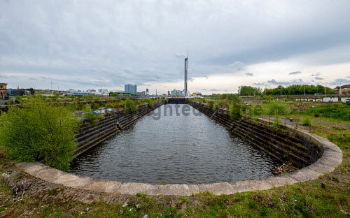 Historic disused graving dock at Govan on the Clyde in Glasgow, Scotland UK. Govan graving dock,graving docks,Glasgow Graving dock,Scotland,Scottish,Shipbuilding,historic,disused,industrial heritage,former,UK,United Kingdom,clydeside,daytime,nobody,dry dock,view