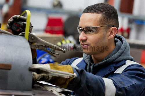 Gow's,  Lybster Ltd, Caithness  Joseph Gunn seen here working on a product  Picture Credit Angus Mackay /HIE 2018,engineering,design,fabrication,installation,Gow's,apprentice,modern,apprentices