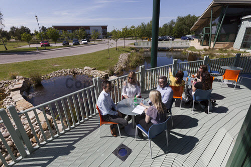 Horizon Scotland, The Enterprise Park Forres, Moray  Breakfast event at Horizon Scotland  People enjoying the  landscaped surrounds in the outdoor space  Picture Credit Gary Doak/HIE 2018,attendees,breakfast,people,business,businesses,meeting,meetings,events,event,social,area,deck,outdoor,space