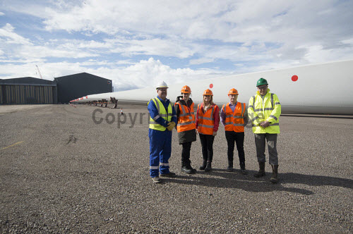 LTR-Rory Gunn (GEG), Jenny Hogan (Scottish Renewables), Claire Mack (SR), Steve Chisholm (GEG), Stephen Thompson (GEG), in front of the Rotra Mare at Nigg Yard.  Nigg Energy Park - operated by GEG - is currently being used as the construction and marshalling port for the SSE-led Beatrice Offshore Wind Farm (BOWL). Siemens Wind Power - who are operating onsite at Nigg - are responsible for the design, manufacture and installation of the 84 wind turbine generators.  Picture Credit Gillian Frampton/HIE 2018,nigg,yard,fabrication,siemens