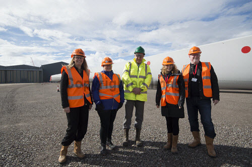 LTR- Elain MacRae HIE,  Gillian Morrison (HIE), Stephen Thompson (GEG), Elaine Hanton HIE, Paul O'Brien (HIE) in front of the Rotra Mare at Nigg Yard.  Nigg Energy Park - operated by GEG - is currently being used as the construction and marshalling port for the SSE-led Beatrice Offshore Wind Farm (BOWL). Siemens Wind Power - who are operating onsite at Nigg - are responsible for the design, manufacture and installation of the 84 wind turbine generators.  Picture Credit Gillian Frampton/HIE 2018,nigg,yard,fabrication,siemens