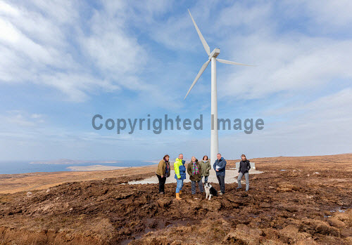 A new wind turbine is now in operation at Achiltibuie.  Pictured L-R: Julia Campbell (Development Officer), Phil Shaughnessy (Director), Anne Campbell (Development Officer), Ann Macleod (Director), 'Scout' (Collie dog), Stuart MacPherson (Head of Strengthening Communities), Lindsay Simpson (Development Manager)  Picture Credit Malcolm McCurrah/HIE wind turbine,renewable energy,green,power,Achiltibuie,Ullapool,5,April,2017
