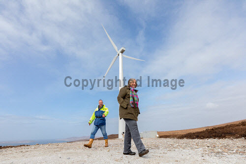 A new wind turbine is now in operation at Achiltibuie.  Pictured L-R: Phil Shaughnessy (Director), 'Scout' (Collie dog), Anne Campbell (Development Officer)  Picture Credit Malcolm McCurrah/HIE wind turbine,renewable energy,green,power,Achiltibuie,Ullapool,5,April,2017