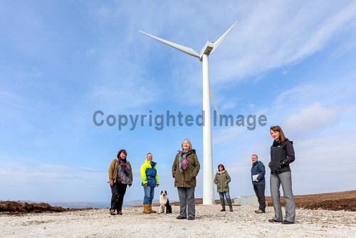 A new wind turbine is now in operation at Achiltibuie.  Pictured L-R: Julia Campbell (Development Officer), Phil Shaughnessy (Director), 'Scout' (Collie dog), Anne Campbell (Development Officer), Ann Macleod (Director), Stuart MacPherson (Head of Strengthening Communities), Lindsay Simpson (Development Manager)  Picture Credit Malcolm McCurrah/HIE wind turbine,renewable energy,green,power,Achiltibuie,Ullapool,5,April,2017