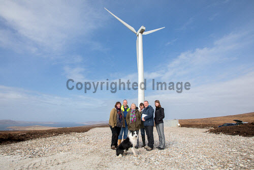 A new wind turbine is now in operation at Achiltibuie.  Pictured L-R: Julia Campbell (Development Officer), Phil Shaughnessy (Director), Anne Campbell (Development Officer), Ann Macleod (Director), Stuart MacPherson (Head of Strengthening Communities), Lindsay Simpson (Development Manager) and 'Scout' (Collie Dog)  Picture Credit Malcolm McCurrah/HIE wind turbine,renewable energy,green,power,Achiltibuie,Ullapool,5,April,2017