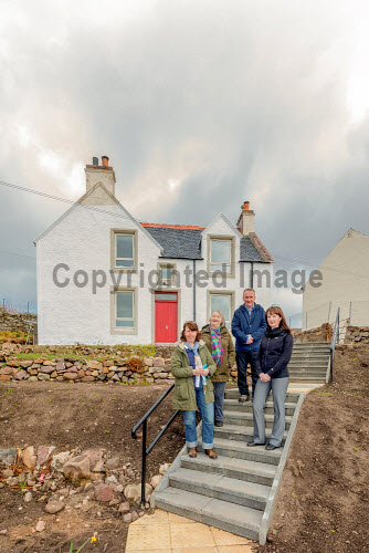 A new wind turbine is now in operation at Achiltibuie. Renovation of the old school house is underway at Achiltibuie. Pictured L-R: Julia Campbell (Development Officer), Lindsay Simpson (Development Manager), Stuart MacPherson (Head of Strengthening Communities),  Anne Campbell (Development Officer)  Picture Credit Malcolm McCurrah/HIE wind turbine,renewable energy,green,power,Achiltibuie,Ullapool,5,April,2017