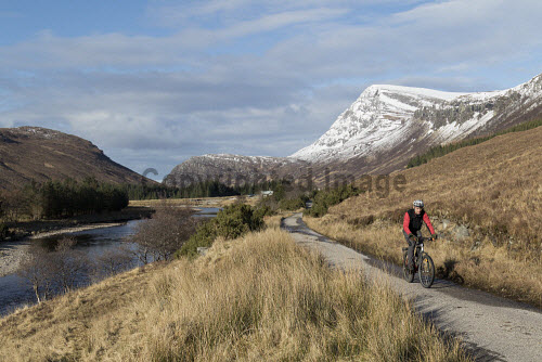 Cycling along Strath More in Sutherland . Highlands of Scotland uk,u.k,Great Britain,GB,G.B,Scotland,Scottish,1 person,daytime,outdoors,sutherland,ben hope,glen,activity,activities,cycling,cyclist,cyclists,bike,bikes,biking,biker,bikers,bicycle,bicycles,mountain,lonely,remote,track,trail,path Mark Ferguson /Scottish Viewpoint