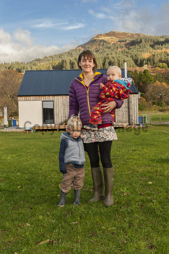Reraig Housing, Balmacara, 15/11/2016  Reraig housing development: Developed by Highlands Small Communities Housing Trust 4 x Rent to Buy homes Built on land previously owned by Kinlochshiel Shinty Club Reraig family, Sarah Littlewood with her children in front of her house  Picture Credit Cailean Maclean/HIE 2016,community,shoot,Balmacara,crofting,housing,reraig