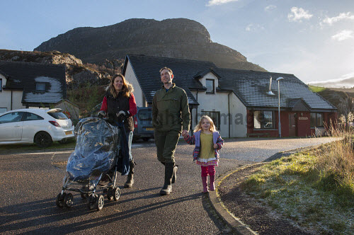 Shieldaig Township 15/11/2016  Former common grazings, partnership project between HSCHT, grazings committee, community council and Albyn Housing Society.  Mixed tenure of private ownership, shared equity, social rent and self build. Total of 15 units  Beth and Charlie Hill with daughter Niamh and son Harry in the buggy.   Picture Credit Cailean Maclean/HIE 2016,community,shoot,shieldaig,crofting,housing,children,buggy,kids