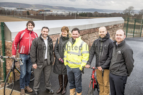 On 12th February 2016, the cycle and pedestrian link between Inverness Campus and Inverness Retail Park was opened, as part of a cycling advocacy event at Inverness College UHI.  Representatives of the project's funders - HIE, Sustrans and Hitrans - were all present at the event, together with the developers (Pat Munro Ltd and Torrance Partnership), the local cycle advocacy group, and Cllr Margaret Davidson and Drew Hendry (MP for Inverness, Nairn, Badenoch & Strathspey).  Here, the developers and the funders of the project including Simon Strain (Sustrans, far left),  Carol Buxton (HIE, 3rd left) and Tom Bishop (Sustrans, 2nd right). Picture Credit Tim Winterburn /HIE Cycle,pedestrian,walk,walkway,link,Inverness,Campus,Retail Park,transport,HIE,2016,south bridge link,activity,activities,cycling,cyclist,cyclists,bike,bikes,biking,biker,bikers,bicycle,bicycles,people