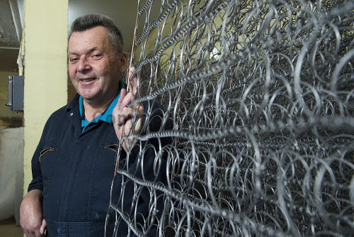 Highland Blindcraft Inverness  Iain Mackay with the wire spring frames  for the mattress   PIC   Trevor Martin /HIE 2016,staff,employees,worker,working,blindcraft,inverness,production,beds,furniture,mattress