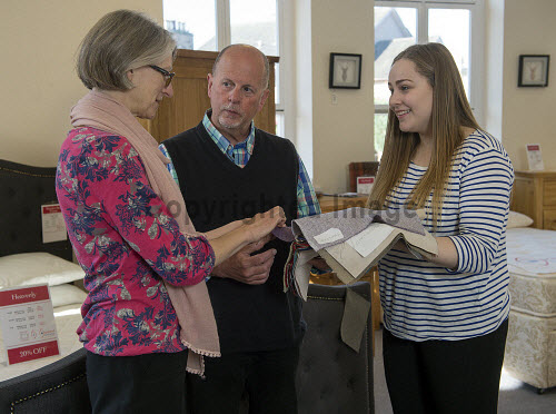 Highland Blindcraft Inverness  Sales assistant Rebecca Thomson shows customers  samples for their furniture   PIC   Trevor Martin /HIE 2016,staff,employees,worker,working,blindcraft,inverness,production,beds,furniture,mattress