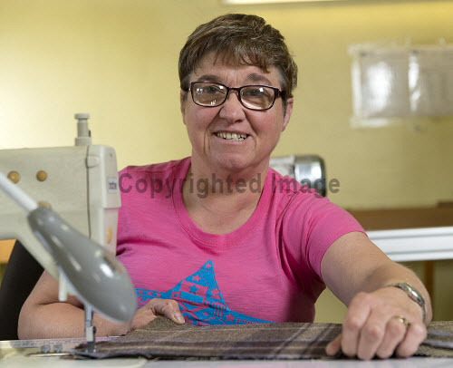 Highland Blindcraft Inverness  Sewing Machinist Christabel  Robertson finishing a headboard   PIC   Trevor Martin /HIE 2016,staff,employees,worker,working,blindcraft,inverness,production,beds,furniture,mattress