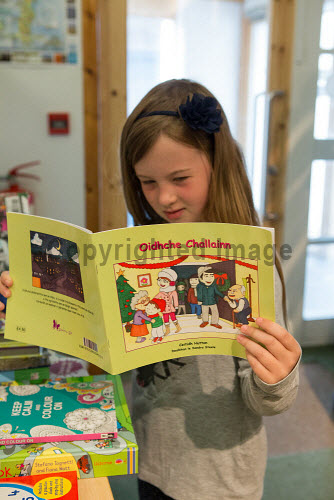 Taigh Chearsabhagh Museum and Arts Centre, Lochmaddy, North Uist   Child with book  Picture Credit Sandie Maciver 2016,gaelic,child,children,learning