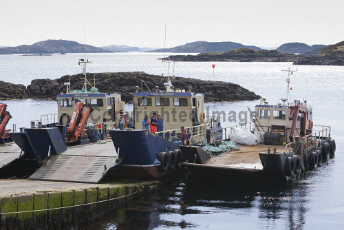Loch Duart Salmon  Staff members with boats  Picture Credit : Gary Doak 2016,Loch Duart,salmon,aquaculture,sutherland,badcall,fishing,cages,cage,pens,pen,workers,worker,fish