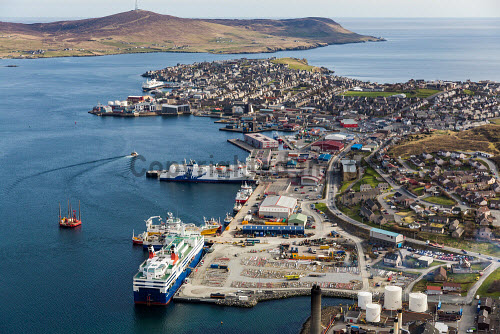 An aerial view of Lerwick harbour with Holmsgarth quayside visible, Mainland, Shetland. The Island of Bressay is behind.