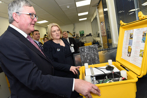 Fergus Ewing MSP, Minister for Energy, Enterprise and Tourism, officially opens the European Marine Science Park (EMSP) at Dunstaffnage, near Oban, Argyll.   Pictured here Fergus Ewing MSP (left) is shown round the facilities by Dr Tracy Shimmield. 21.11.14 2014,highlands,islands,enterprise,development,investment,offices,Malin House,SAMS,research,Scottish Association,Marine Science,economy