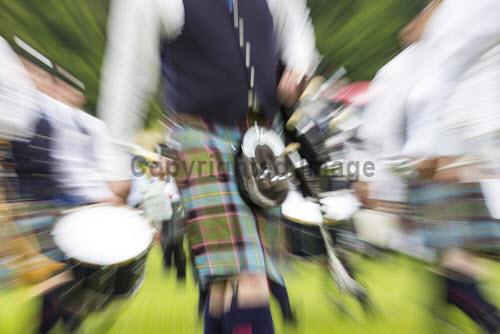Piping Hot - the European Pipe Band Championships in Grant Park,  Forres, Moray. 28.06.14  Picture Credit : John Paul / HIE 2014,highlands,islands,enterprise,event,tartan,kilt,kilts,bagpipes,piper,pipers,pipeband,pipebands,sporran,sporrans,pipes,drum,drums,detail,details
