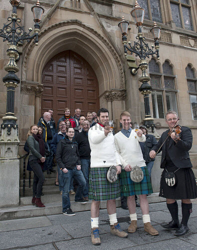 The launch of the Inverness Whisky Festival, Inverness, Highlands of Scotland. Pictured here the crowd gather outside the Town House on Bridge Street in the city centre of Inverness. Picture Credit : Trevor Martin / HIE 2014,highlands,islands,enterprise,attraction,city,distilleries,distillery,dram,drink,drinking,drinks,event,glass,glasses,malt,promote,promotion,sample,sampling,single,taste,tasting,tourist,traditional,visitor,kilt,kilts,tartan,people,musician,fiddle,fiddler,crowd
