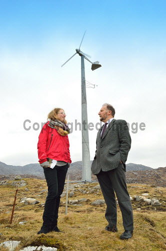 Ruth Cape, Membership and Marketing Officer, Community Land Scotland and David Cameron, Chairman Community Land Scotland. Tarbert, Isle of Harris. 4/03/2013..Seen here with Urgha wind turbine in the background..Picture credit: John MacLean /HIE graduate,placement,talent,scotland,2013,isle,islands