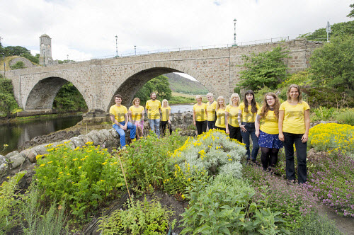 Timespan Museum, Cafe and Arts Centre, Helmsdale, Sutherland, Highlands of Scotland. Pictured here the staff posing for a photograph in the gardens. 13.08.13  Picture Credit : Angus Mackay / HIE 2013,highlands,islands,enterprise,attraction,visitor,tourist,tourism,art,gallery,heritage,community,venue,programme,meeting,place,past,future,history,bridge,river Angus Mackay / HIE