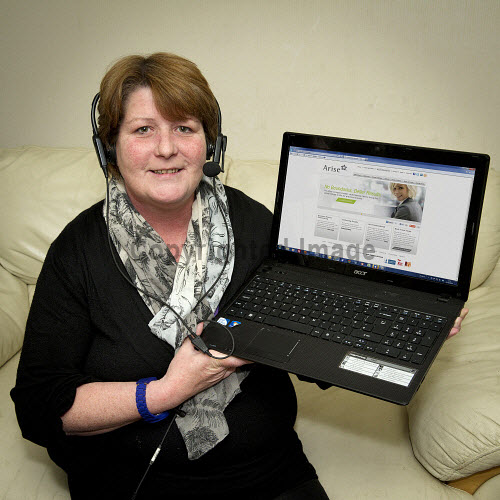 Arise Home Worker, Mairi Macleod, Thurso, Caithness, Highlands of Scotland..Arise Virtual Solutions Inc. is the world's leading provider of virtual business process outsourcing and contact center services for brands seeking to improve business results through their sales and service channels...Picture Credit : Angus Mackay / HIE 2013,highlands,islands,enterprise,homeworking,homeworker,computer,laptop,screen,keyboard,interior,headset
