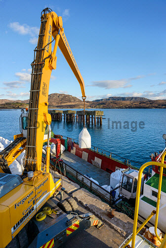 Loading a boat at Kishorn Port and Dry Dock - a joint venture between Ferguson Transport (Spean Bridge) Ltd and Leiths (Scotland) Ltd. The site is for the manufacturing, laydown and assembly of renewable energy devices for offshore wind, wave and tidal sectors as well as oil and gas and decommissioning..11.03.13..Picture Credit : Alex Ingram / HIE 2013,highlands,islands,enterprise,winter,sunny,manufacture,construction,shipping,berth,berths,navigation,deep,water,docks,quayside,industry,loch
