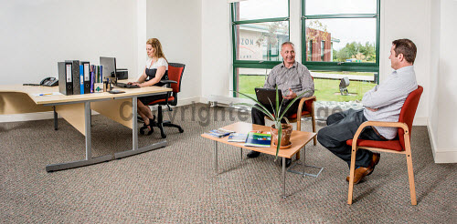 Stock Photography around Enterprise Park Forres, August 2013.  Here,  models in one of the available office spaces in Horizon Scotland. Picture Credit : Tim Winterburn / HIE Highlands,Islands,Enterprise,HIE,Moray,Forres,Horizon,Scotland,2013,work,working,computer,office,offices,telephone,lady,woman,women,ladies,worker,workers,computers,stockshot,generic,men,man,people Tim Winterburn / HIE