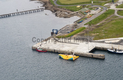 Lyness Pier, Hoy, Orkney with the Wello Penguin wave energy converter visible...Picture Credit : Mike Brookes Roper / HIE 2012,highlands,islands,enterprise,summer,water,development,site,potential,marine,energy,park,harbour,boats,coast,coastal,island,isle