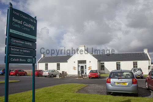 Ionad Chaluim Chille Ile - The Islay Columba Centre, a gaelic college offering a progressive year round range of classes, courses and activities and also offering many community facilities including a gaelic library, cafe, conference room and an exhibition space, Bowmore, Islay, Inner Hebrides...Pictured here the sign outside the building...Picture Credit : Mark Unsworth / HIE 2012,highlands,islands,enterprise,sunny,íle,ICCI,venue,culture,heritage,language,education,study,island,isle,argyll,cars,car,park