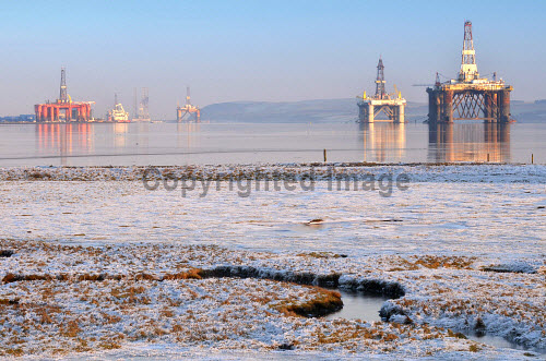 Oil rigs in the Cromarty Firth at Invergordon, Highland, viewed from near the Dalmore Distillery at Alness...Picture Credit : Tim Winterburn / HIE 2012,highlands,islands,enterprise,gas,rig,energy,industrial,industry,landscape,scenic,sunny,winter,cold,frost,reflection,water,atmospheric,platform,petro,chemical,petrochemical