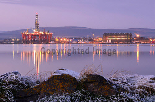 Oil rigs in the Cromarty Firth at Invergordon, Highland, viewed from  Newhall point on Black Isle at a spectacular winter dusk...Picture Credit : Tim Winterburn / HIE 2012,highlands,islands,enterprise,gas,rig,energy,industrial,industry,landscape,scenic,sunny,winter,cold,frost,water,atmospheric,platform,petro,chemical,petrochemical,sunset,hills,reflection