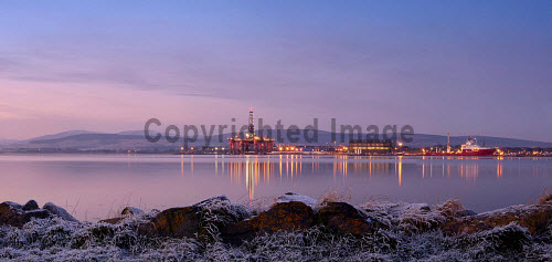 Oil rigs in the Cromarty Firth at Invergordon, Highland, viewed from  Newhall point on Black Isle at a spectacular winter dusk...Picture Credit : Tim Winterburn / HIE 2012,highlands,islands,enterprise,gas,rig,energy,industrial,industry,landscape,scenic,sunny,winter,cold,frost,water,atmospheric,platform,petro,chemical,petrochemical,sunset,hills,reflection,panoramic
