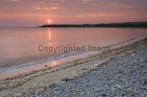 Sunset at the Bay of Skaill, Mainland, Orkney..Picture Credit : Iain Sarjeant 2012,island,islands,isle,isles,summer,coast,coastal,coastline,atmospheric,dramatic,silhouette,orb,reflection,beach,water,sand,sandy,scenic