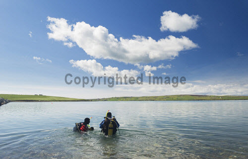 Two divers in the water off Churchill Barrier No. 3 connecting Glimps Holm and Burray, Orkney..Picture Credit : Iain Sarjeant 2012,island,islands,isle,isles,summer,sunny,activity,activities,diving,scuba,water,sound,scapa,flow,diver,dive,clouds,people,person,scenic