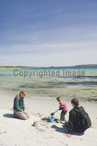 A family on the beach at Newark Bay, Mainland, Orkney..Picture Credit : Iain Sarjeant 2012,summer,sunny,island,islands,isle,isles,activity,activities,people,person,beach,sand,sandy,white,child,children,kid,kids,family,families,sandcastle,sandcastles,bucket,spade,play,playing,mum,dad,mother,father,couple,scenic