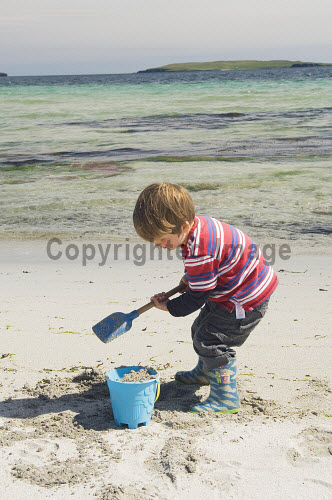 A child on the beach at Newark Bay, Mainland, Orkney..Picture Credit : Iain Sarjeant 2012,summer,sunny,island,islands,isle,isles,activity,activities,people,person,beach,sand,sandy,white,child,children,kid,kids,family,families,sandcastle,sandcastles,bucket,spade,play,playing,scenic