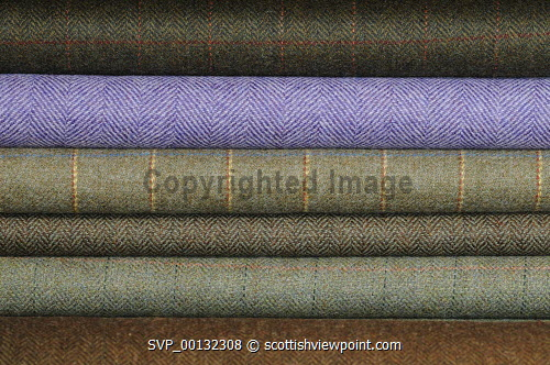 Breanish Tweed - a family based business at Port of Ness on the Isle of Lewis, Outer Hebrides..Breanish Tweed hand weaves a lightweight tweed using 100% natural yarn, all dyed and spun in Scotland..Cloth is supplied to the best bespoke tailors and fashion houses...Pictured here a detail of samples of the cloth...31.07.10...Picture Credit: Leila Angus / HIE western isles,island,development,highlands,islands,enterprise,2010,material,manufacture,industry,handmade,clothiong,interior