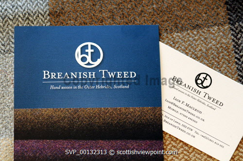 Breanish Tweed - a family based business at Port of Ness on the Isle of Lewis, Outer Hebrides..Breanish Tweed hand weaves a lightweight tweed using 100% natural yarn, all dyed and spun in Scotland..Cloth is supplied to the best bespoke tailors and fashion houses...Pictured here a detail of the Breanish tweed logo on samples of cloth...31.07.10...Picture Credit: Leila Angus / HIE western isles,island,development,highlands,islands,enterprise,2010,material,manufacture,industry,handmade,clothiong,interior,label