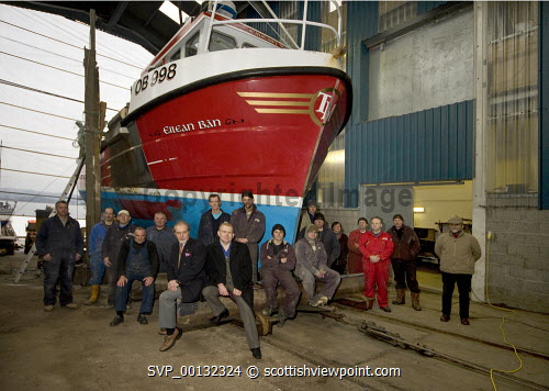 Colin Campbell and Colin McLean, HIE photographed with boatyard staff at Crinan Boatyard Ltd. Crinan, Argyll...Picture Credit : Dennis Hardley / HIE 2010,BOAT,REPAIR,SLIPPING,SHED,MARINE,INDUSTRY,BOATS,JANUARY Dennis Hardley / HIE