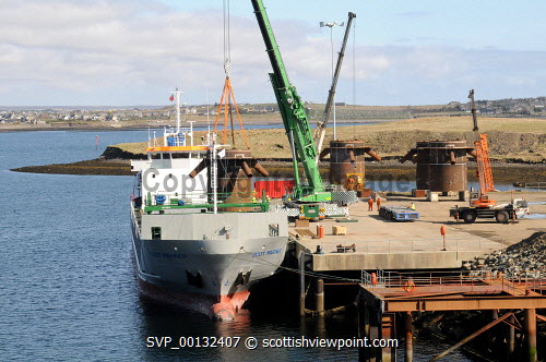 Loading of a ship at Arnish Fabrication Yard - the key manufacturing and assembly facility for the renewable energy sector in the Western Isles, Arnish Point, Isle of Lewis, Outer Hebrides..03.05.10..Picture Credit: Leila Angus / HIE western isles,island,development,facilities,highlands,islands,enterprise,2010,industry,sunny,coast,coastal,quay,harbour