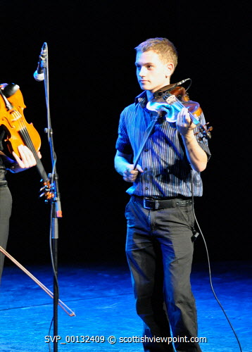 Fisean groups Fis a' Bhaile and Fis na h-ñige, and multi-award winning Kiltearn Fiddlers on stage at the Blas 2010 Finale, Eden Court, Inverness..12.09.10.Pictured here a fiddle player...Picture Credit : Tim Winterburn / HIE musicians,young,feisean,feis,highlands,islands,enterprise,performance,traditional,music,perform,performers,instruments,stage,musical