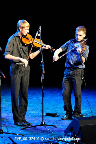 Fisean groups Fis a' Bhaile and Fis na h-ñige, and multi-award winning Kiltearn Fiddlers on stage at the Blas 2010 Finale, Eden Court, Inverness..12.09.10.Pictured here two fiddle players...Picture Credit : Tim Winterburn / HIE musicians,young,feisean,feis,highlands,islands,enterprise,performance,traditional,music,perform,performers,instruments,stage,musical