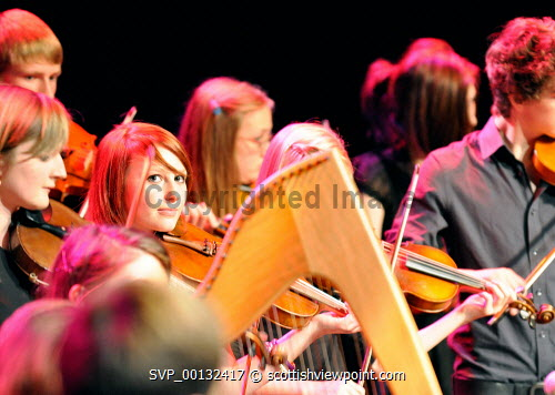 Fisean groups Fis a' Bhaile and Fis na h-ñige, and multi-award winning Kiltearn Fiddlers on stage at the Blas 2010 Finale, Eden Court, Inverness..12.09.10..Picture Credit : Tim Winterburn / HIE musicians,young,feisean,feis,highlands,islands,enterprise,performance,traditional,music,perform,performers,instruments,stage,musical