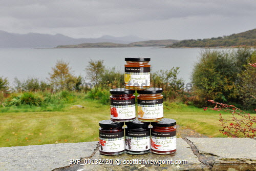 Lady Claire MacDonald, renowned Scottish cook, has relaunched a delicious range of classic and contemporary preserves and sauces, from the Michelin-starred Kinloch Lodge Hotel, Sleat, Isle of Skye. .Pictured here a selection of products in the Lodge's gardens, with views over the Sound of Sleat towards Knoydart on the Scottish mainland..15.10.10..Picture Credit: Tim Winterburn / HIE 2010,highlands,islands,enterprise,food,retail,produce,local,marmalade,sauce,jam,jams